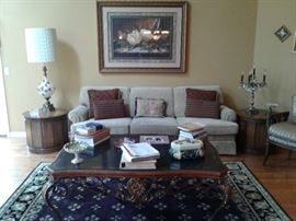 Pair of drum tables. Pristine sofa. Ornate coffee table.