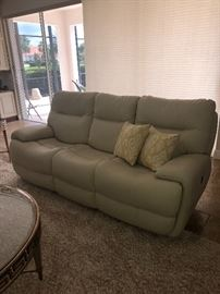 New cream colored recliner sofa