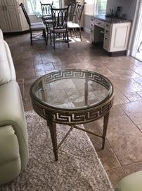 Two Round gold glass top end table