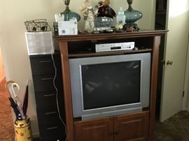 Tv, Tv cabinet, storage items, painted milk can, umbrellas
