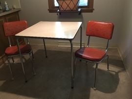 Sweet vintage chrome table with two chairs in retro red vinyl print