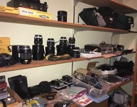 Camera/slide equipment: lenses, cameras, movie cameras, flashes, reels, equipment for recording, viewing, and more! Several shelves