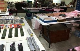 Loads of HO scale model trains, many still in boxes and unused