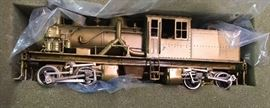 Sample brass HO scale model train engine in original box; high-end brass collection sold separately