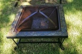 Backyard fire pit with screen and accessories