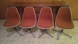 Set (4) of Eames sideshells on swivel star bases