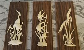 Ivory seascape art on teak