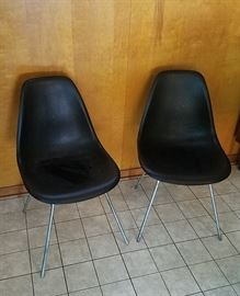 pair of black shell chairs on Eames H bases