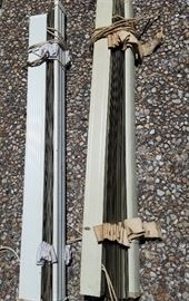 An example of some of the MANY vintage blinds...both metal and wood. All have cloth tapes - very 50's!