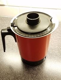 red metal coffee pot with base and all attachments