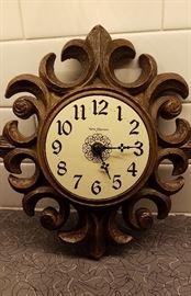 small wooden sunburst wall clock