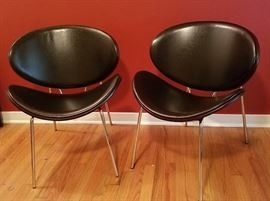 wow. very cool pair modern chairs
