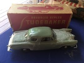 Vintage studebaker tin toy car