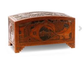 Canton Export Carved Hardwood Trunk, domed, elaborately relief Carved to all sides depicting figures amidst pagodas and other architecture and landscapes