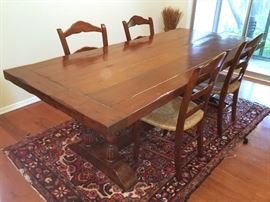 Walnut trestle table with French walnut chairs from Old Plank Brocante.