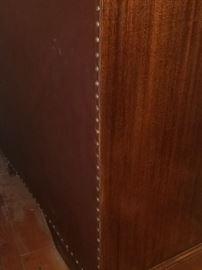 Studded leather backing