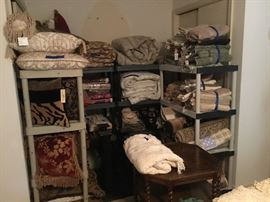 Lots of bedding, decorative pillows, towels, most of them brand new with tags on.