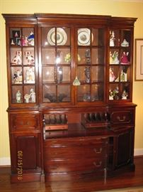 Magnificent breakfront with butler's desk and molded glass. Must see to appreciate!