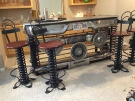 Daniel Barrett, celebrated Sculpture artist, took parts from a car and turned it into a very COOL bar!