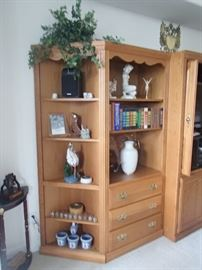 wall unit with collectibles including Rosenthal nudes