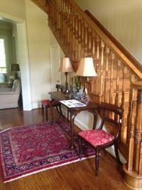 Lovely entry with an entry/sofa table & beautiful lamps, rug, and chairs