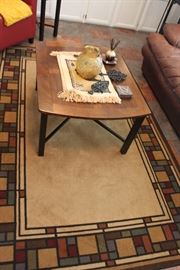 coffee table, mid century pitcher, cast iron trivets, geometric rug