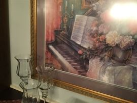 Vintage piano print and glass candlesticks.