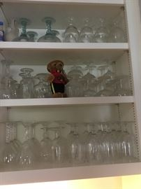 Vintage glassware guarded by a RC Mountie bear!