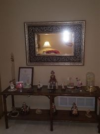 "Including frame, 29"" tall by 40"" wide beveled glass mirror; sofa table; figurines and collectibles."