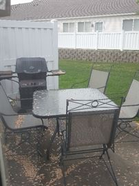 Outdoor patio furniture and grill. Not pictured - umbrella.