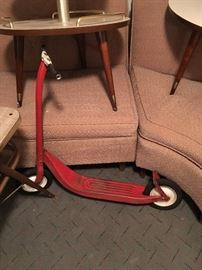 vintage red metal scooter