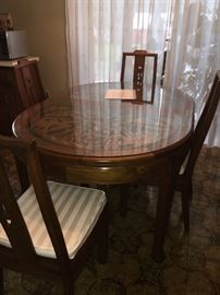 Gorgeous and unique table with enclosed engravings.