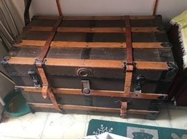 Old Steamer Trunk in very good condition.   With leather straps.