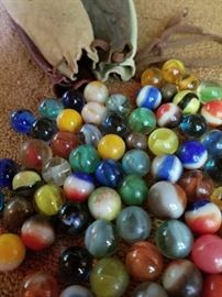 Bag of Marbles, Leather Bag (lot of marbles and drawstring leather bag).                          https://ctbids.com/#!/description/share/31918