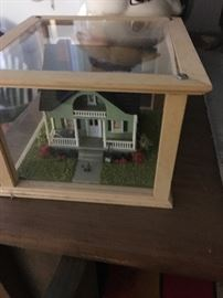 Miniature dollhouse encased in glass