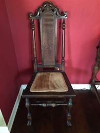 Antique cane back chair.