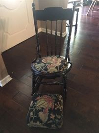 Antique small rocking chair with matching footstool.