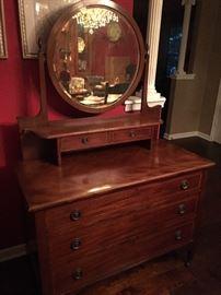 Antique dresser with swing mirror.