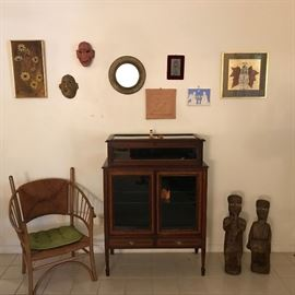 Beautiful Two Tier Display Case, Art Work By Mary Ann Bower And Nancy Bandy, Theatrical Mask,  Barrel Back Chair, Tunisian Statues