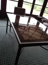 Large glass-top table with chairs.  Try to buy those at the store and pay over a grand.