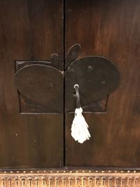 Hand made heart shaped locks on 12 ft cabinet.