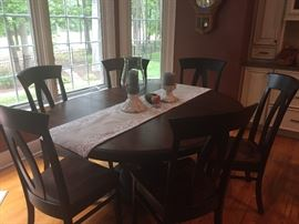 Beautiful Conrad Grebel Amish made dining table and six chairs.  Also there matching bar stools.