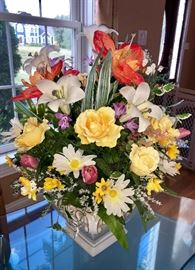 Several beautiful silk flower arrangements