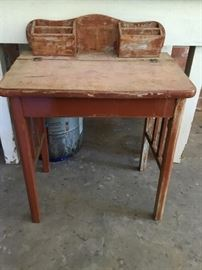 70-75 year old student desk. Needs repair and refinishing.