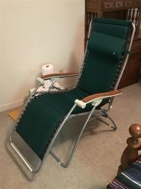 Ergo Lounger cushioned zero-gravity chair. Never been left outside overnight or in the rain.