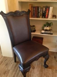 One of the 8 matching dining chairs