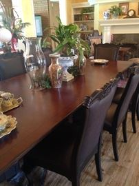 Large dining table with 8 matching chairs