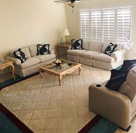 Like new, very clean matching Sofa, Love Seat, Coffee and End Tables and Area Rug