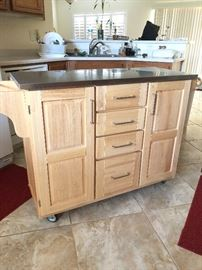 Washed Oak Kitchen Island with stainless steel top and flip-out bar