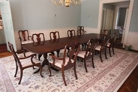 "Henkel-Harris  dining room table with 12 armchair dining chairs (we have additional armchairs).  The table as pictured measures 12' 7"".  Can be shortened by at least 2', and with additional leaves can be extended 2'."